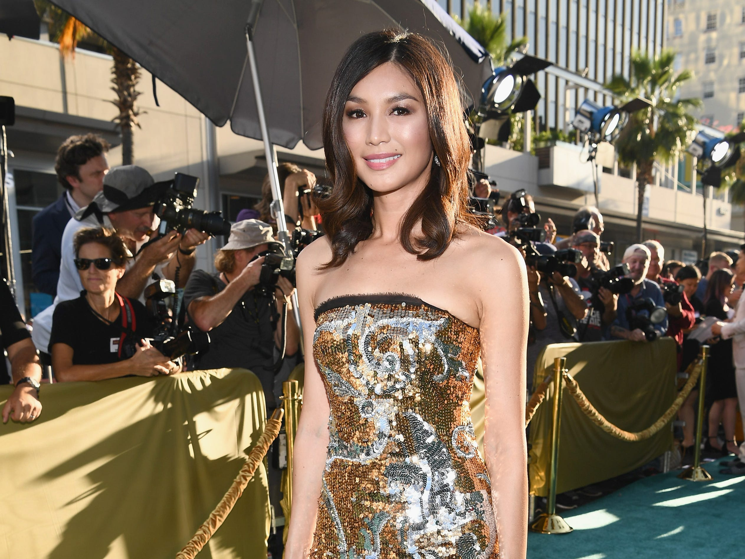 "Gemma Chan, who plays Nick's cousin on ""Crazy Rich Asians,"" was dripping sparkle in a gold and silver sequined dress."