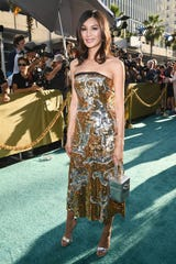 "Gemma Chan, who plays Nick's cousin in ""Crazy Rich Asians,"" was dripping sparkle in a gold-and-silver sequined dress."