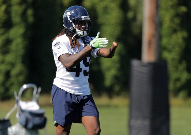 Seattle Seahawks linebacker Shaquem Griffin stands on the field during NFL football training camp, Thursday, July 26, 2018, in Renton, Wash.