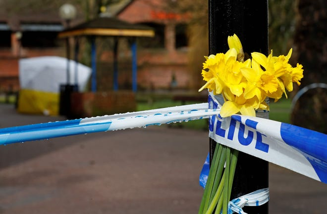 Flowers grace a police cordon at The Maltings shopping centre in Salisbury, southern England, where former Russian spy Sergei Skripal and his daughter Yulia were found critically ill March 4, 2018, after being apparently poisoned with what was later identified as a nerve agent.
