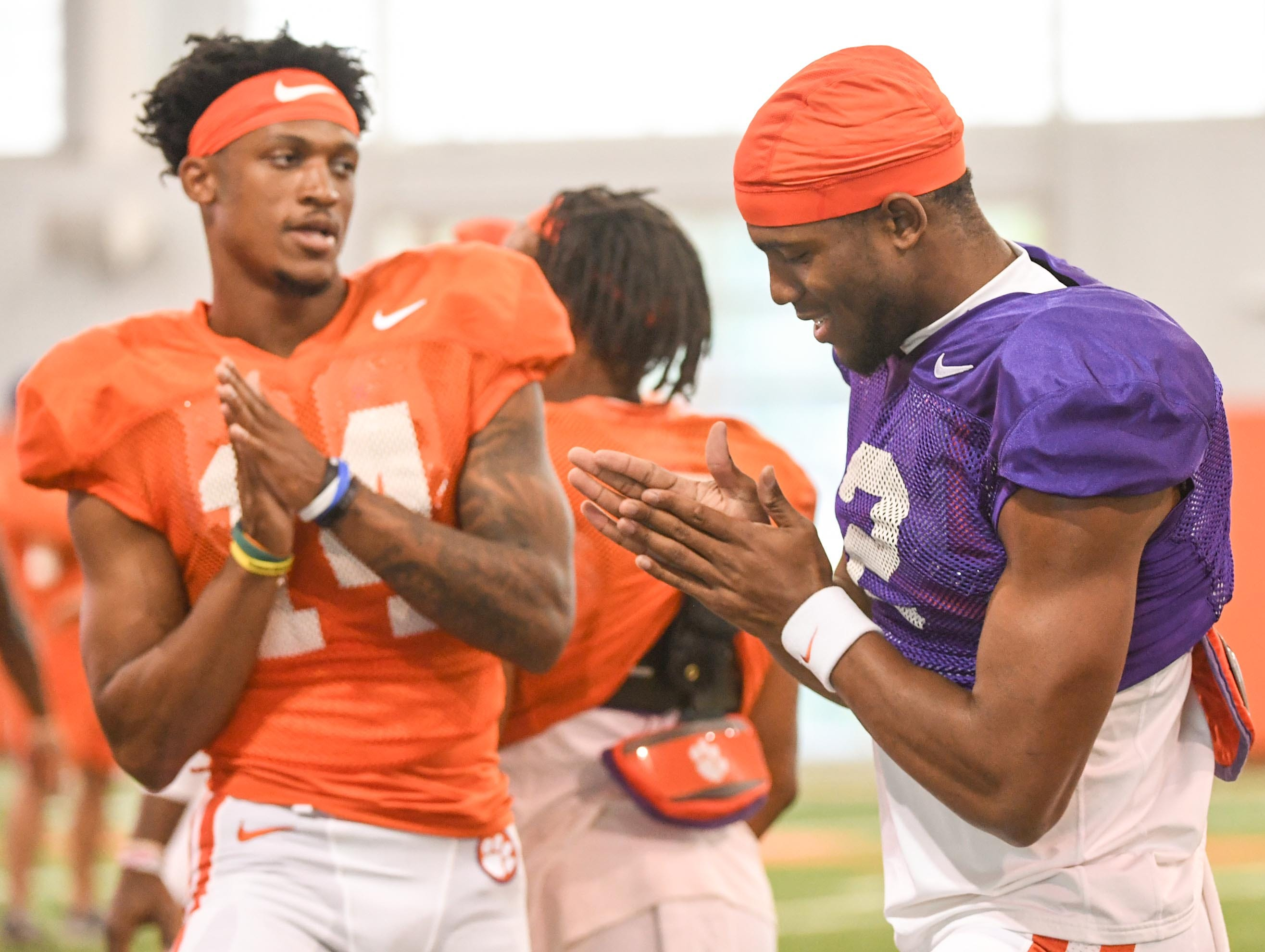 Clemson wide receiver Diondre Overton (14), left, and quarterback Kelly Bryant (2) greet each other during fall practice in Clemson on Wednesday.