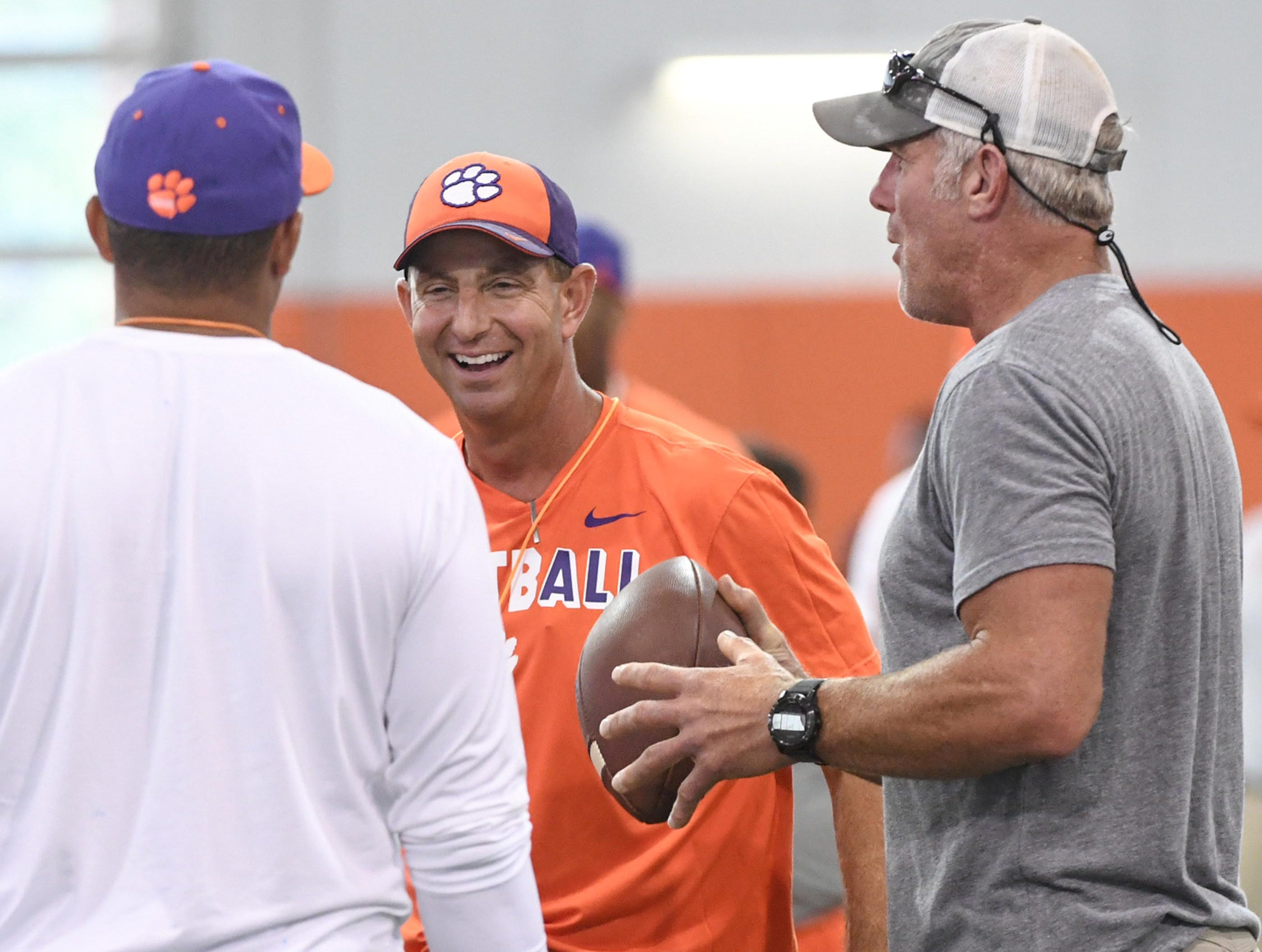Clemson head coach Dabo Swinney and Brett Favre during fall practice in Clemson on Wednesday.