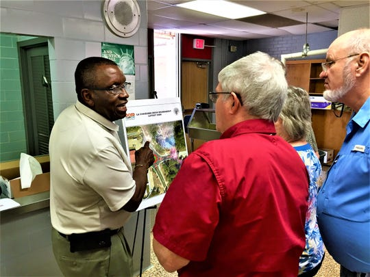 Pineville Mayor Clarence Fields (left) talks with citizens at a public meeting  Wednesday about a planned roundabout at Edgewood and Susek drives.