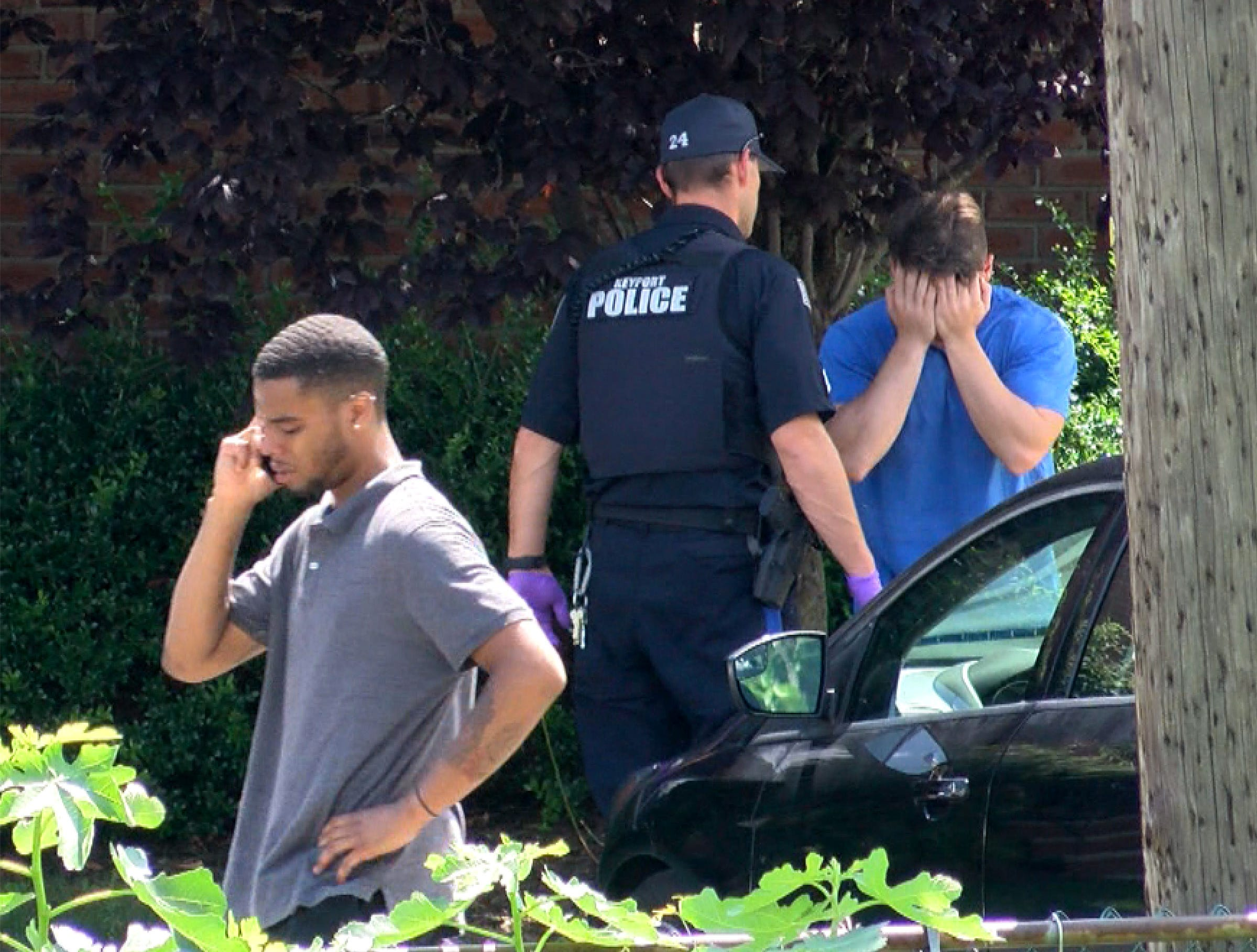 Relatives arrive along Center Street Thursday afternoon, August 9, 2018, where a man was apparently shot.