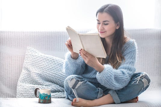Girl On The Couch Reading A Book