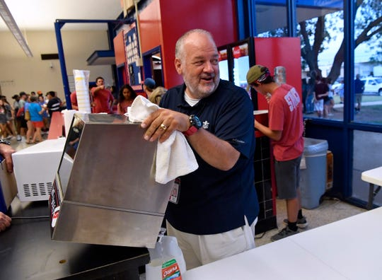 Jimmy Pogue's resume includes serving as Student Council sponsor, a job that often involves a hands-on experience working at the Cougar Gym concession stand.