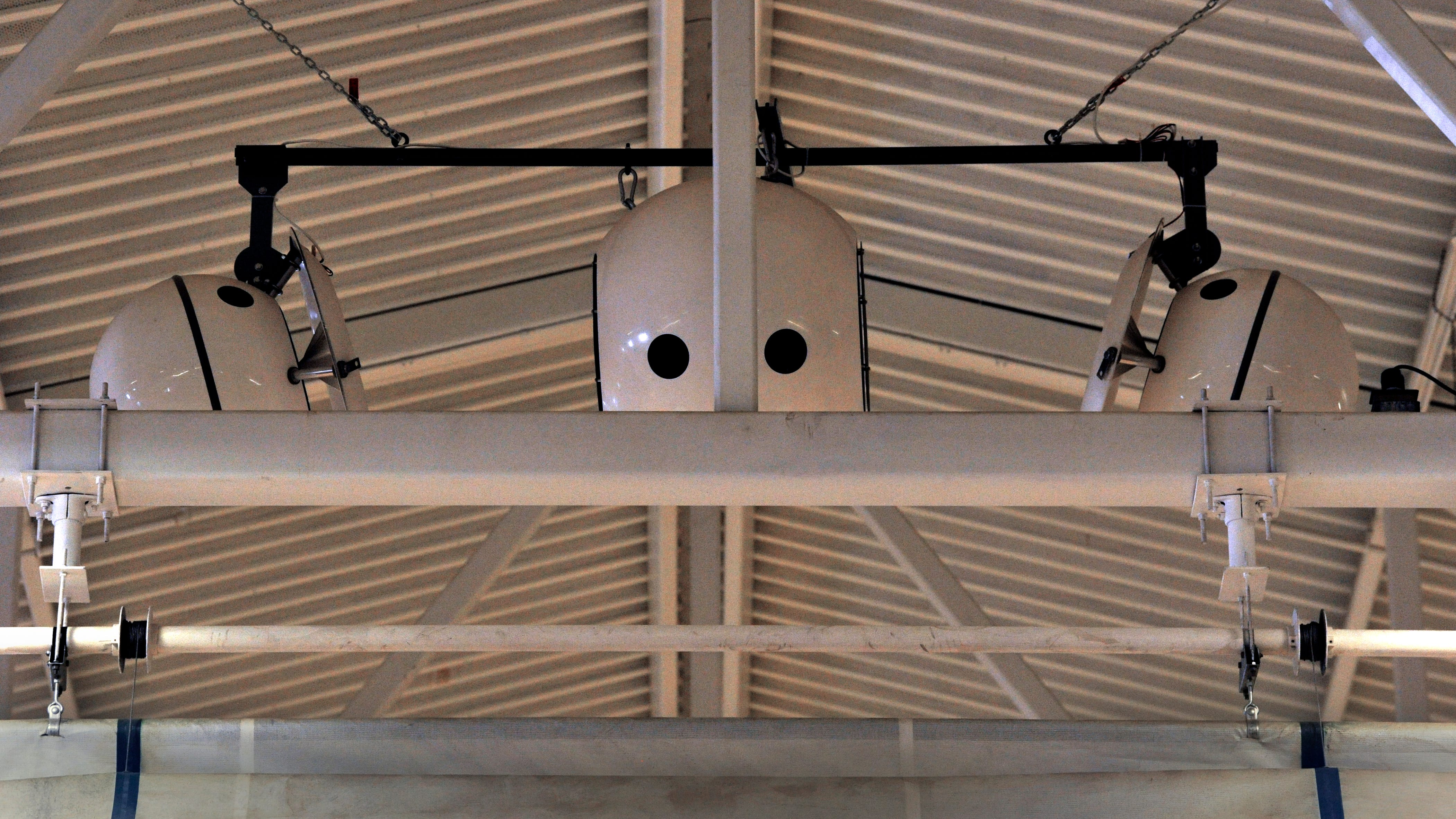 """Equipment hanging from the ceiling of the gymnasium at TSTC Sweetwater was reminiscent of the robot from """"The Iron Giant May 26, 2018. The devices are actually speakers, the """"nose"""" being one of the supports for the ceiling."""