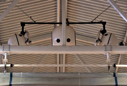 "Equipment hanging from the ceiling of the gymnasium at TSTC Sweetwater was reminiscent of the robot from ""The Iron Giant."" The devices actually are speakers, the ""nose"" being one of the supports for the ceiling."