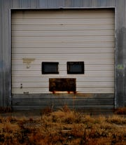 A warehouse door off Interstate 20 near Merkel seems to have a face reminiscent of former Chicago Bears coach Mike Ditka.