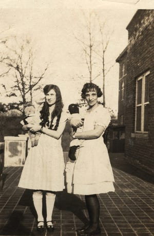 Alice Benton, right,and Virginia Bryan pose with dolls at Cullowhee Normal and Industrial School in this 1924 photo.The school eventually became Western Carolina University.