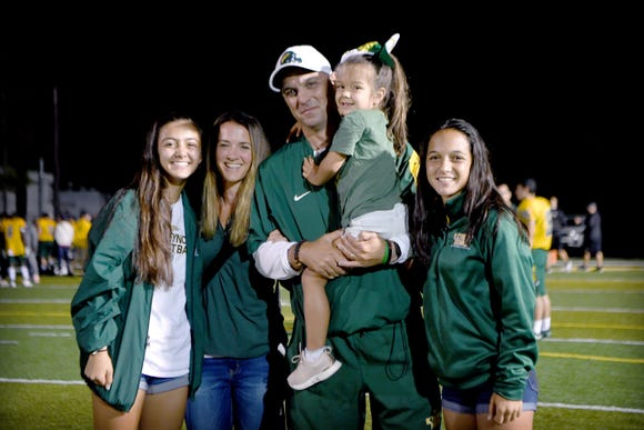 Reynolds coach Shane Laws poses with his wife, Katie, and their three daughters, Anna and Grace, both 14 and Gia, 4, following the Reynolds Football Jamboree at Reynolds High School on Wednesday, Aug. 8, 2018.