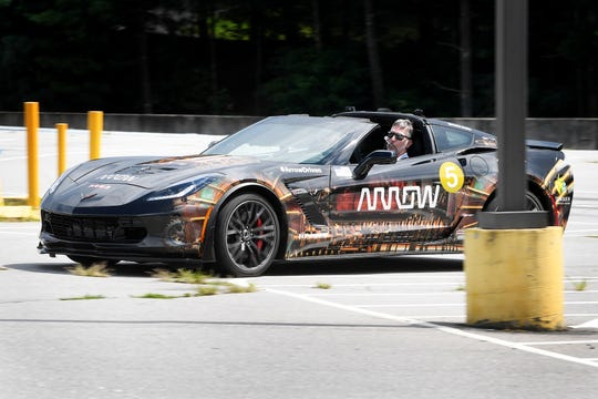 Paul Endry drives the Arrow Electronics Semi-Autonomous Motorcar Tuesday. The vehicle accelerates and brakes with a sip-and-puff device while sensors mounted to sunglasses allow head tilting motions to steer.