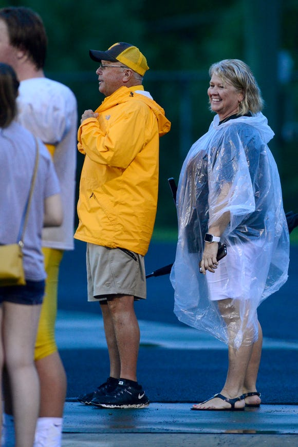Kelly Gentry and her husband, Murphy football coach David Gentry, chat with players as they exit the field following the Reynolds Football Jamboree at Reynolds High School on Wednesday, Aug. 8, 2018.