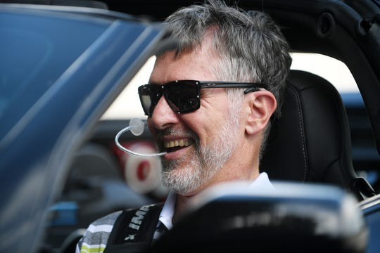 Paul Endry sits in the driver seat of the Arrow Electronics Semi-Autonomous Motorcar Tuesday. The vehicle accelerates and brakes with a sip-and-puff device while sensors mounted to sunglasses allow head tilting motions to steer.