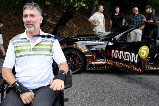 Paul Endry, an Asheville optometrist, was paralyzed in a cycling accident last year. On Tuesday, he had the opportunity to drive the Arrow Electronics Semi-Autonomous Motorcar. The vehicle accelerates and brakes with a sip-and-puff device while sensors mounted to sunglasses allow head tilting motions to steer.