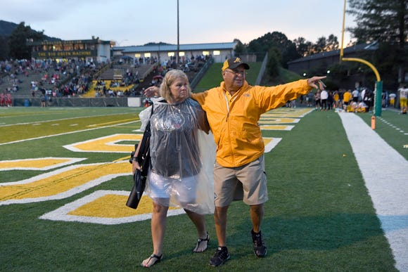 Kelly Gentry and her husband, Murphy football coach David Gentry, walk off the field following the Reynolds Football Jamboree at Reynolds High School on Wednesday, Aug. 8, 2018.