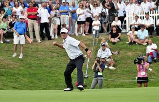 Willie Wood reacts to his 35-foot putt on the final hole of regulation in 2012. He defeated Michael Allen in a playoff.
