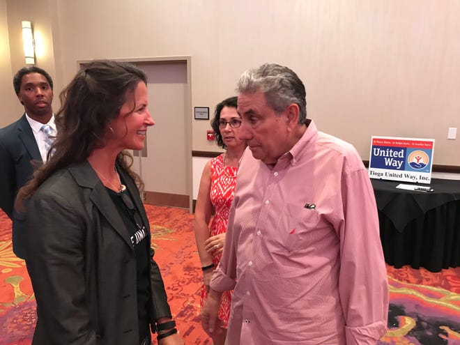 Carolyn Palladino (left), executive director of the Tioga County United Way, talks with Tioga Downs Resort & Casino owner Jeff Gural at a ceremony at the Tioga Downs Hotel and Conference Center. The ceremony honored Gural for his contributions to United Way member organizations.