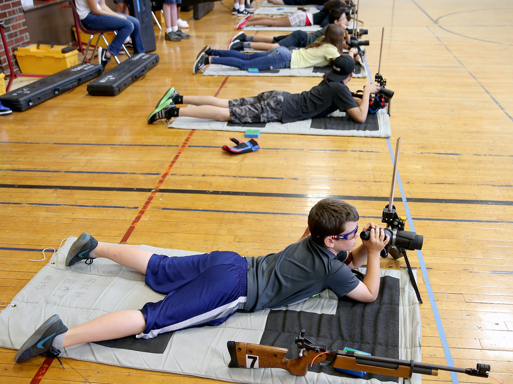 Tyce Outhwaite, 9, of Port Orchard checks the target to shoot at the South Kitsap High School NJROTC Wolf Battalion Rifle Camp runs from August 8-10, at the National Guard Armory in Port Orchard.The camp teaches rifle safety, and shooting technics.