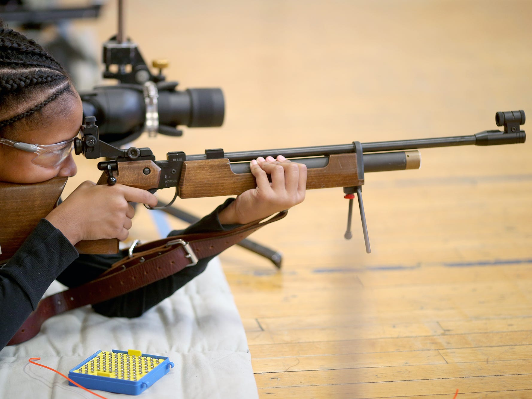 Student Aniya Clark of Port Orchard shoots at the target after shooting at the South Kitsap High School NJROTC Wolf Battalion Rifle Camp runs from August 8-10, at the National Guard Armory in Port Orchard.The camp teaches rifle safety, and shooting technics.