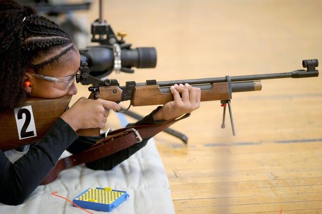 Aniya Clark of Port Orchard shoots at a target during the South Kitsap High School NJROTC Wolf Battalion Rifle Camp, which took place Aug. 8-10 at the National Guard Armory in Port Orchard. The camp teaches rifle safety and shooting technics.