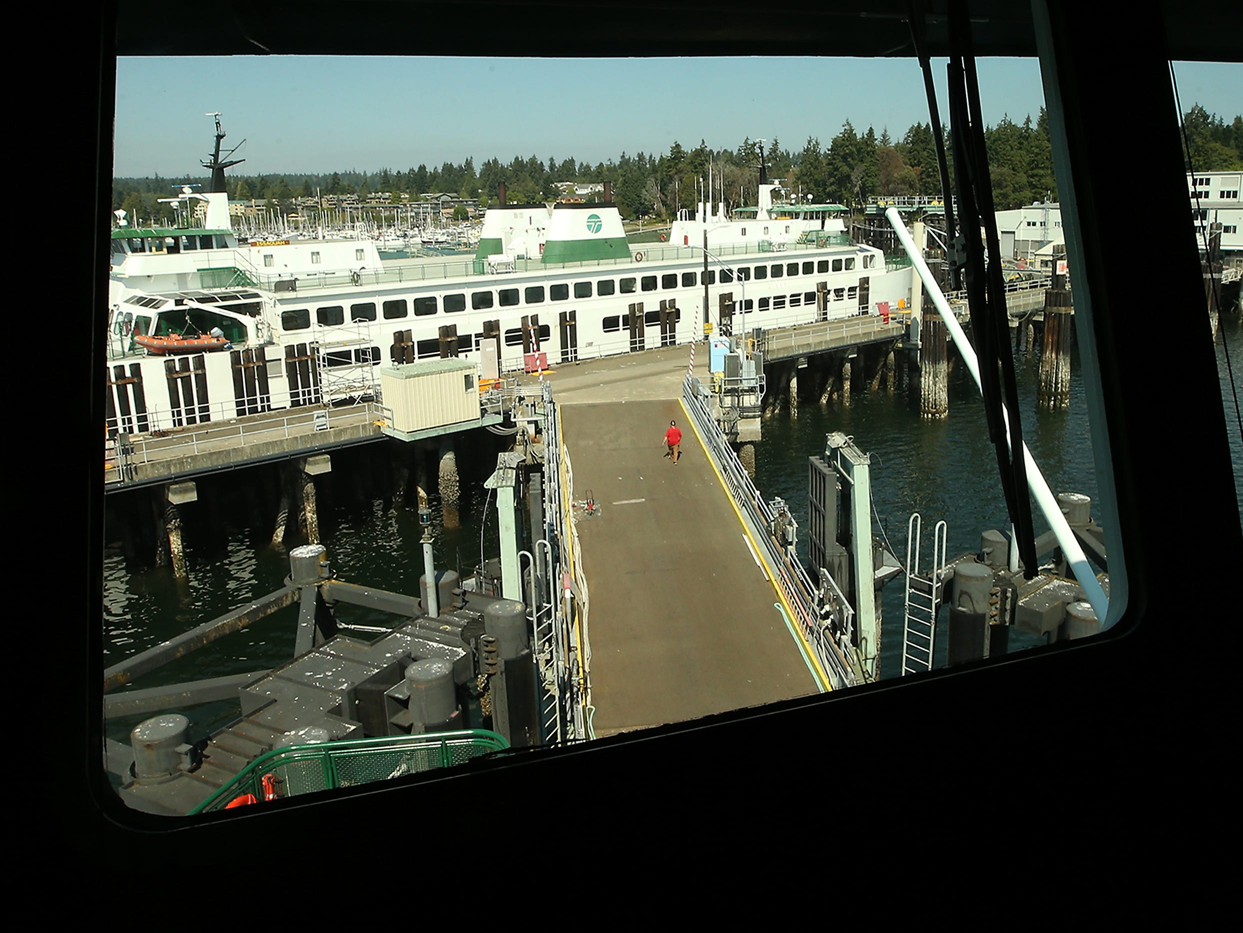 The Washington State Ferry Issaquah is framed in the pilot house window of the M/V Suquamish at the Eagle Harbor Maintenance Facility on Thursday, August 9, 2018.