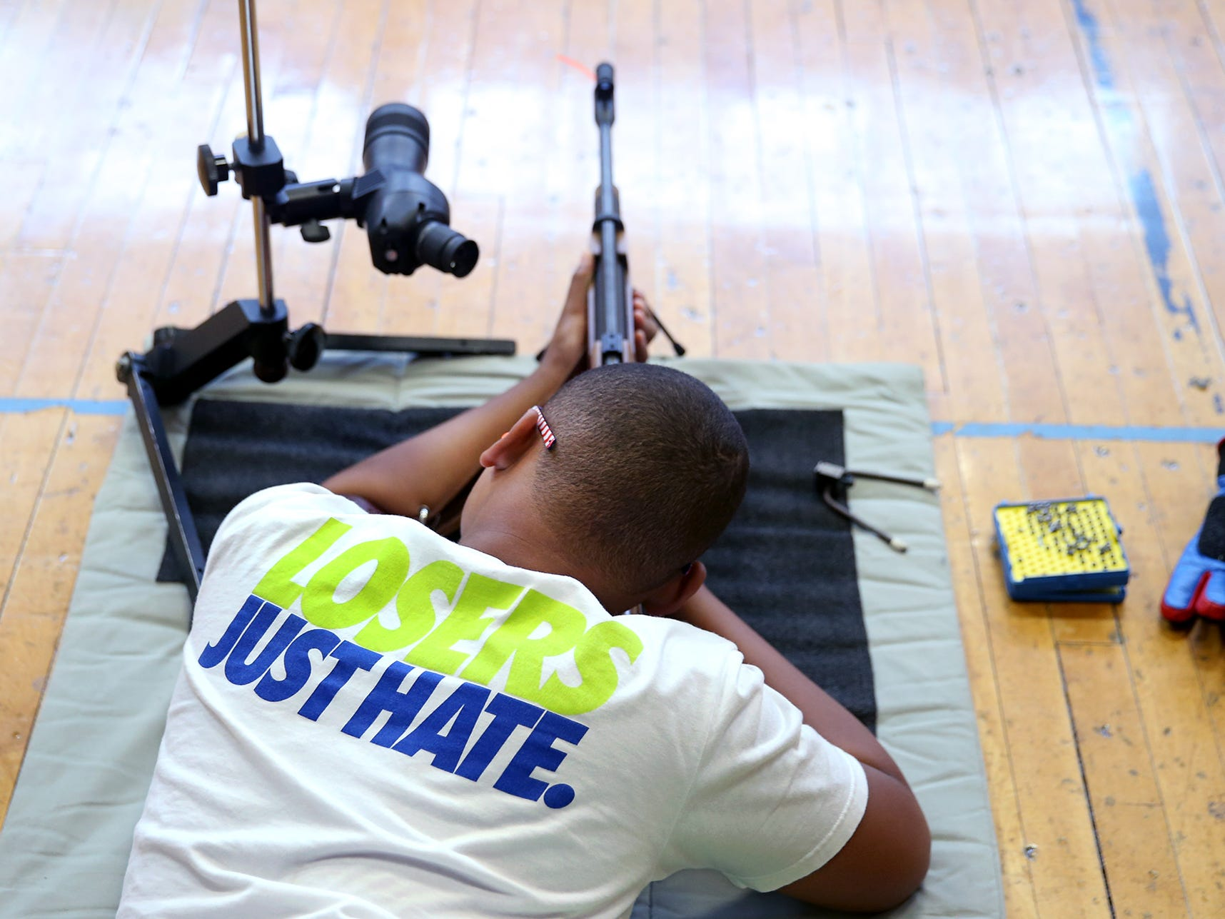 Student Keion Clark, 12, of Port Orchard shoots the target at the South Kitsap High School NJROTC Wolf Battalion Rifle Camp runs from August 8-10, at the National Guard Armory in Port Orchard.The camp teaches rifle safety, and shooting technics.