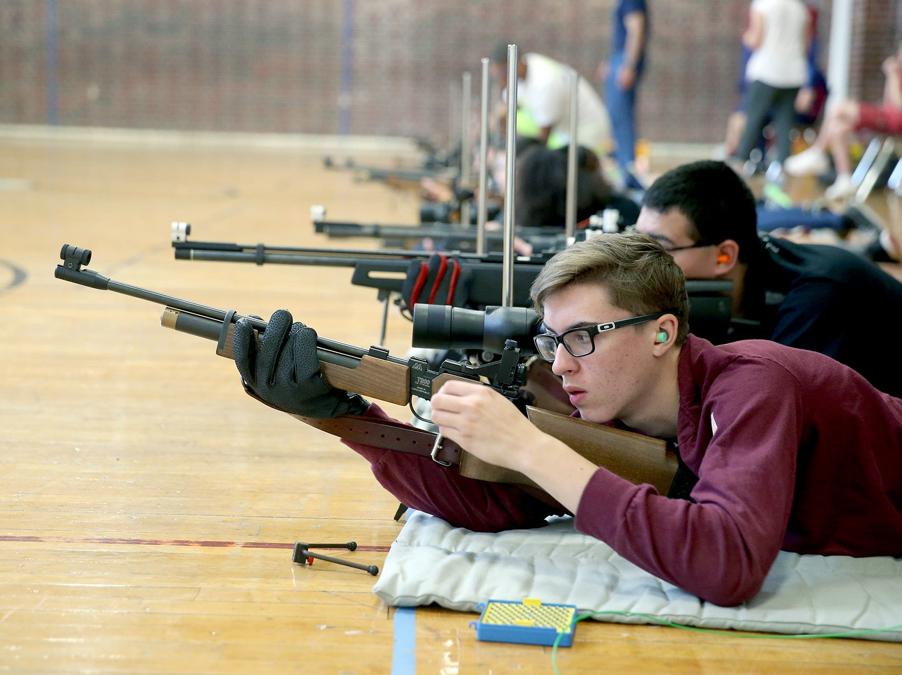 SK NJROTC member Jacob Saurer, 16, readies his rifle aim at the South Kitsap High School NJROTC Wolf Battalion Rifle Camp runs from August 8-10, at the National Guard Armory in Port Orchard.The camp teaches rifle safety, and shooting technics.