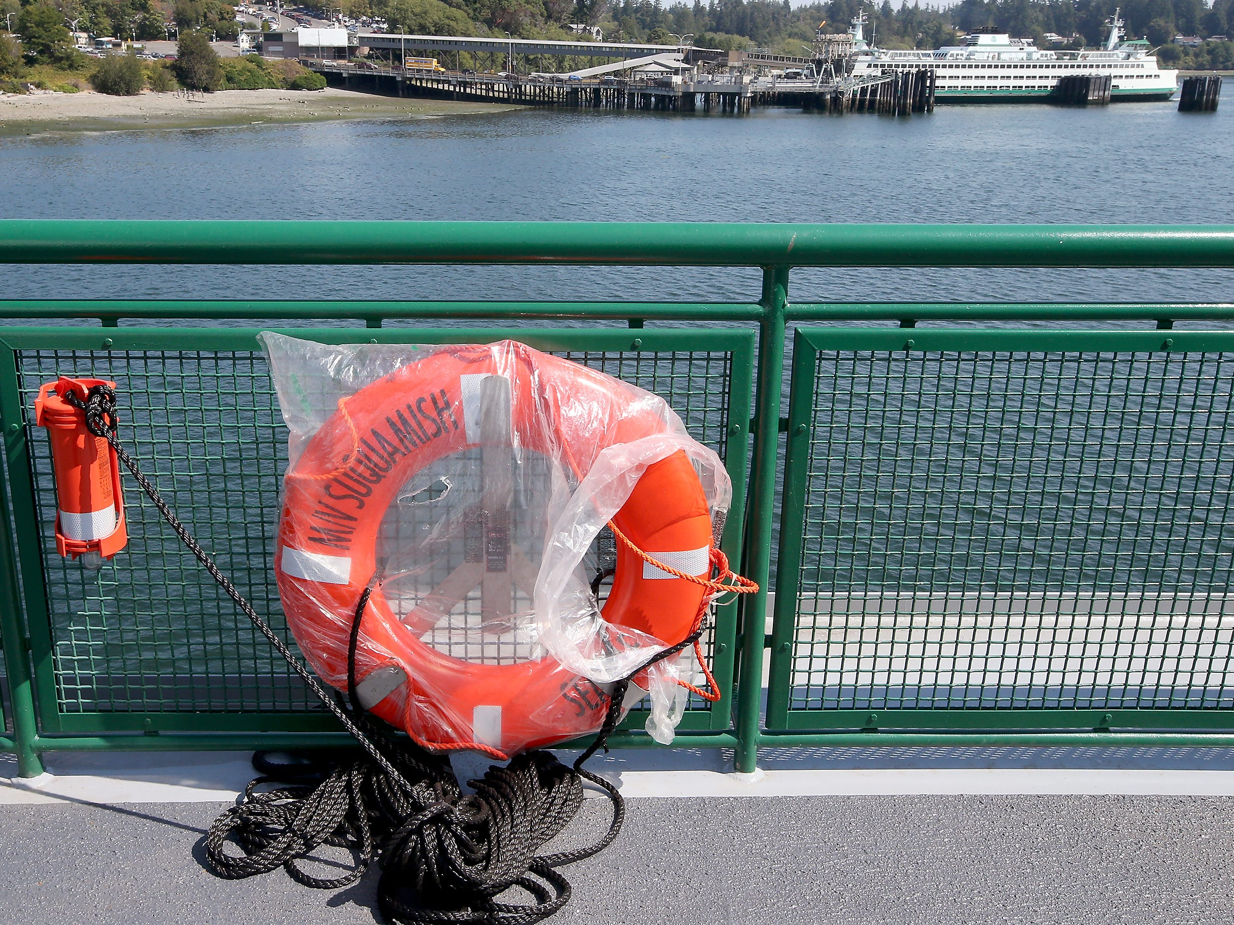 A life ring still inside plastic wrap awaits unwrapping aboard the top passenger deck of the Washington State Ferry Suquamish at the Eagle Harbor Maintenance Facility on Thursday, August 9, 2018.