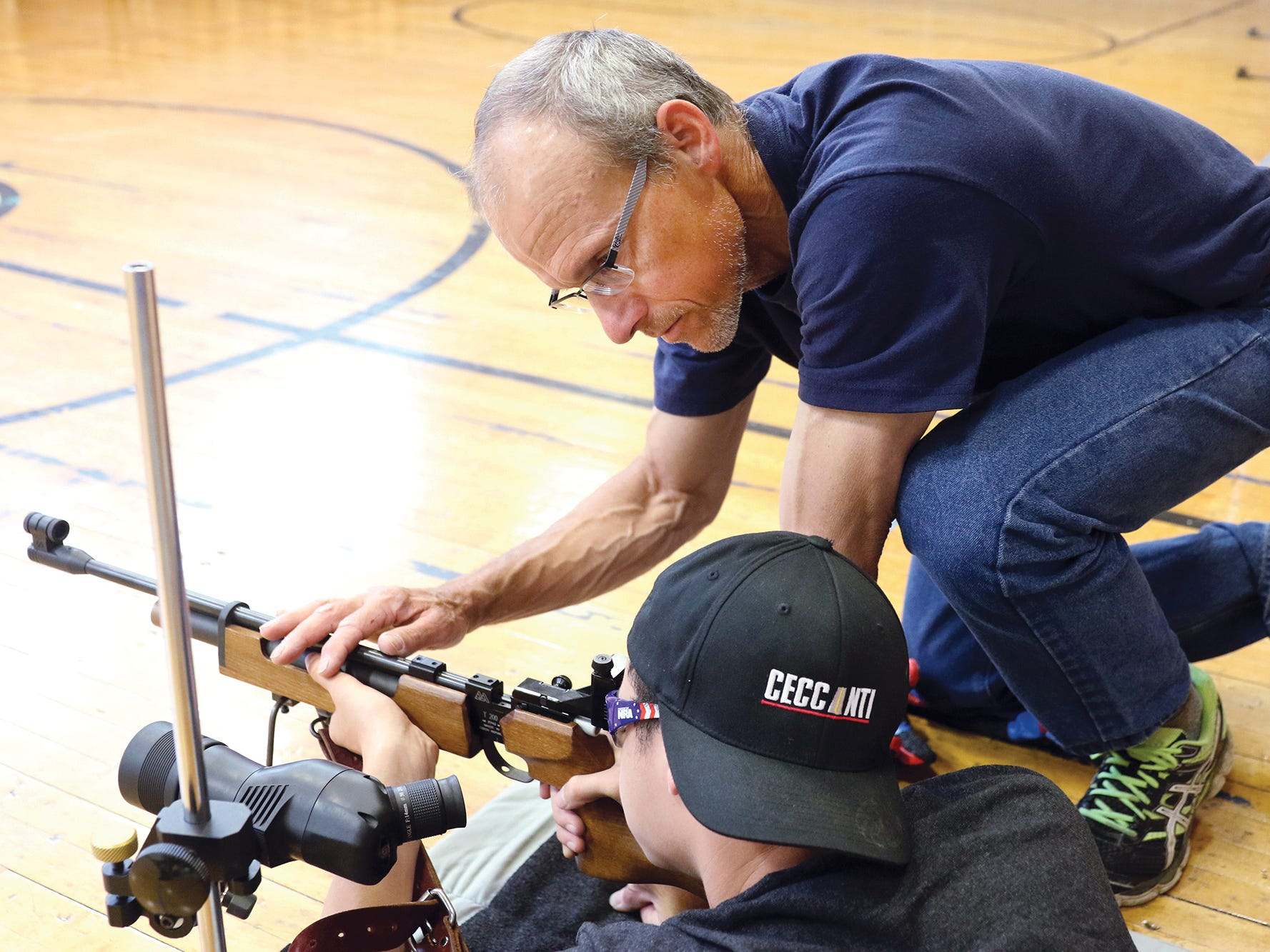 Student Braden Brown, 15, is helped with rifle position by instructor Jeff Phillips at the South Kitsap High School NJROTC Wolf Battalion Rifle Camp runs from August 8-10, at the National Guard Armory in Port Orchard.The camp teaches rifle safety, and shooting technics.He is an SK NJROTC member.