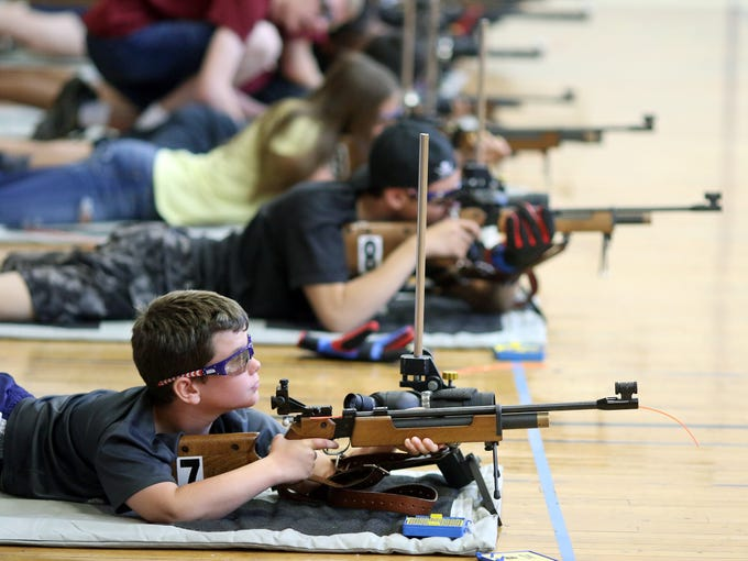Tyce Outhwaite, 9, of Port Orchard looks up at the target to shoot at the South Kitsap High School NJROTC Wolf Battalion Rifle Camp runs from August 8-10, at the National Guard Armory in Port Orchard.The camp teaches rifle safety, and shooting technics.