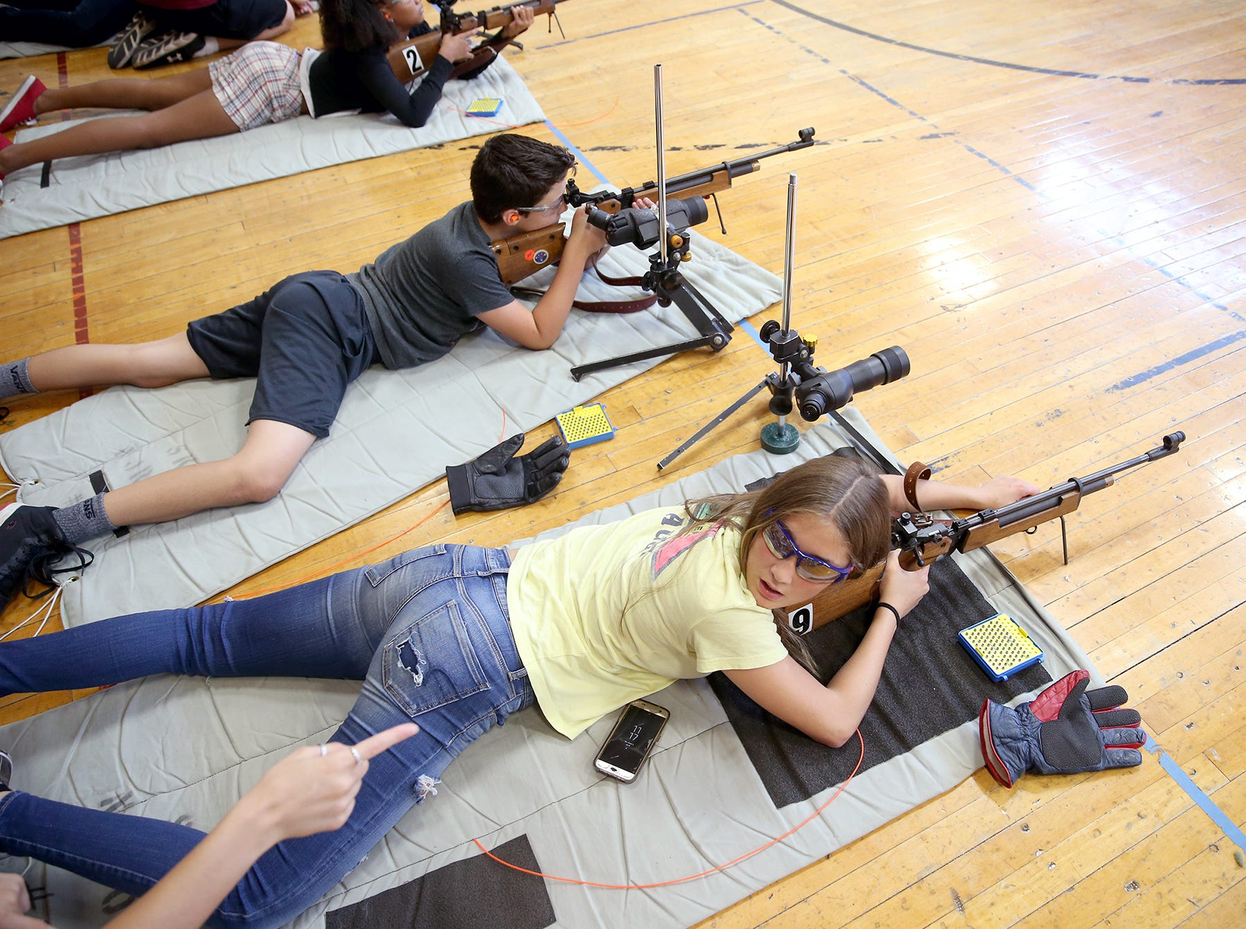 Hailey Roberts, 15, of Port Orchard looks at her twin sister Brooklyn for pointers at the South Kitsap High School NJROTC Wolf Battalion Rifle Camp runs from August 8-10, at the National Guard Armory in Port Orchard.The camp teaches rifle safety, and shooting technics.She is a student in the Sk NJROTC program,