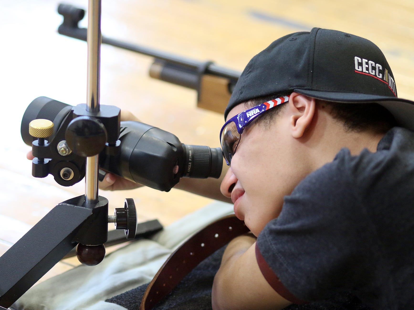 Student Braden Brown, 15, scopes out the target at the South Kitsap High School NJROTC Wolf Battalion Rifle Camp runs from August 8-10, at the National Guard Armory in Port Orchard.The camp teaches rifle safety, and shooting technics.He is an SK NJROTC member.