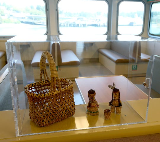 The interior of the ferry Suquamish is decorated with tribal art.