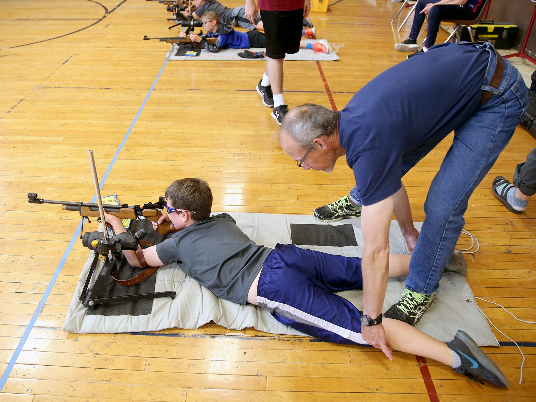 Tyce Outhwaite, 9, of Port Orchard gets help from instructor Jeff Phillips on his prone shooting position at the South Kitsap High School NJROTC Wolf Battalion Rifle Camp runs from August 8-10, at the National Guard Armory in Port Orchard.The camp teaches rifle safety, and shooting technics.