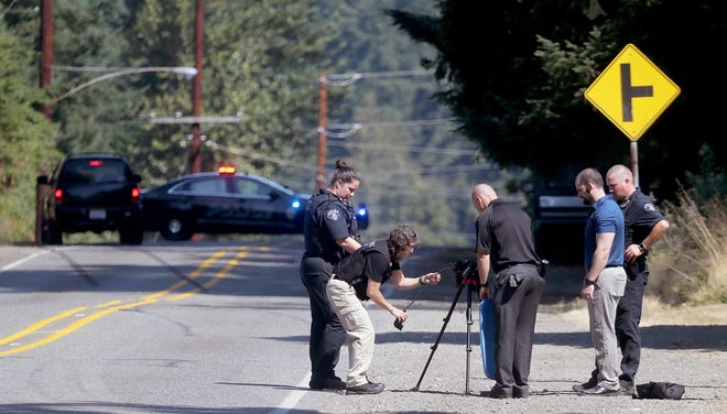 Bremerton Police Department investigators work the scene of a fatality accident on National Avenue in Bremerton on Thursday.