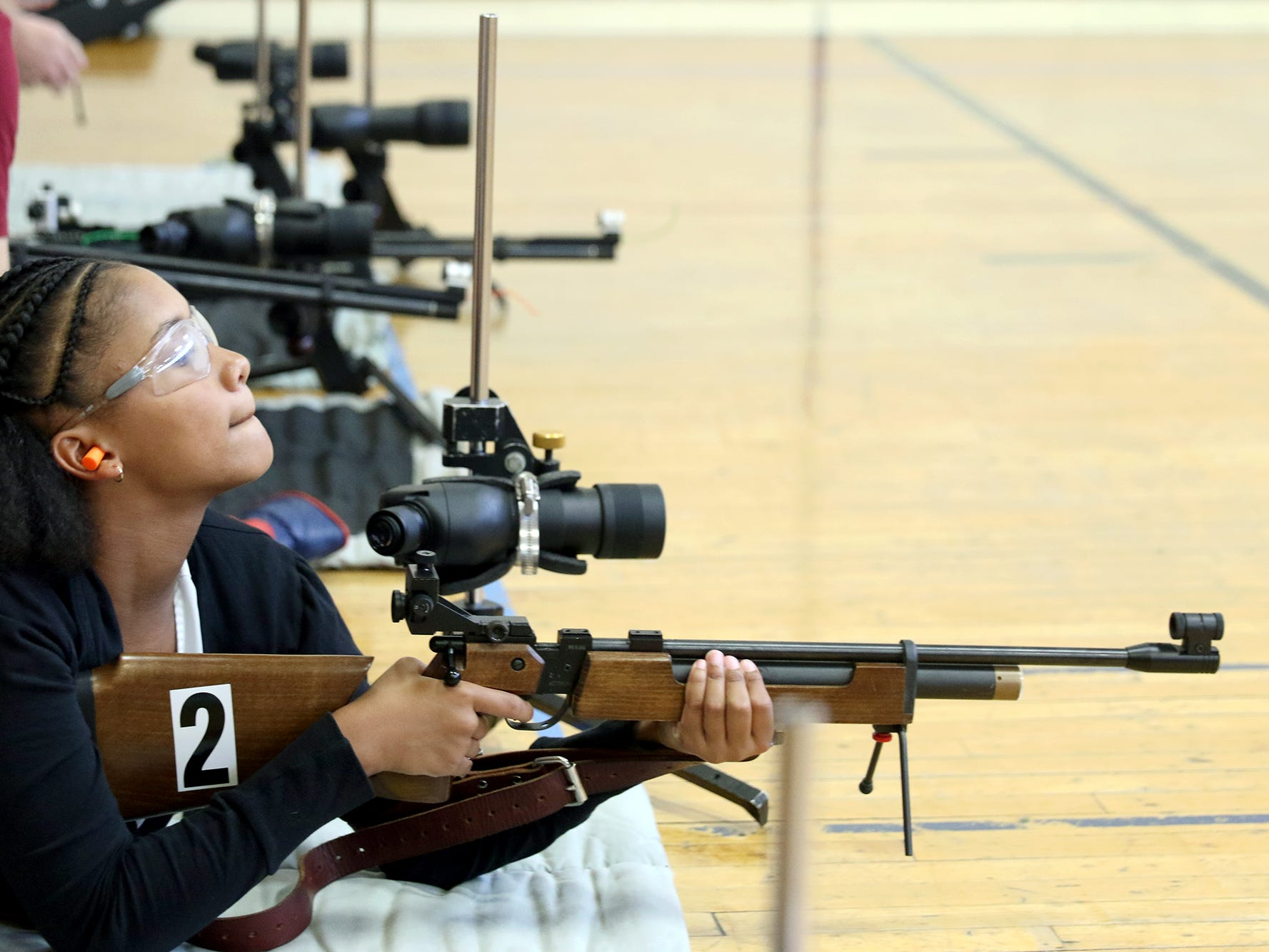 Student Aniya Clark of Port Orchard looks at her shooting target at the South Kitsap High School NJROTC Wolf Battalion Rifle Camp runs from August 8-10, at the National Guard Armory in Port Orchard.The camp teaches rifle safety, and shooting technics.