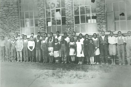 Children stand outside of Clear View Elementary School, which stood with Mills Chapel Baptist Church on the site where the Carver Community Center now sits, before it was sold to Buncombe County in 1946.