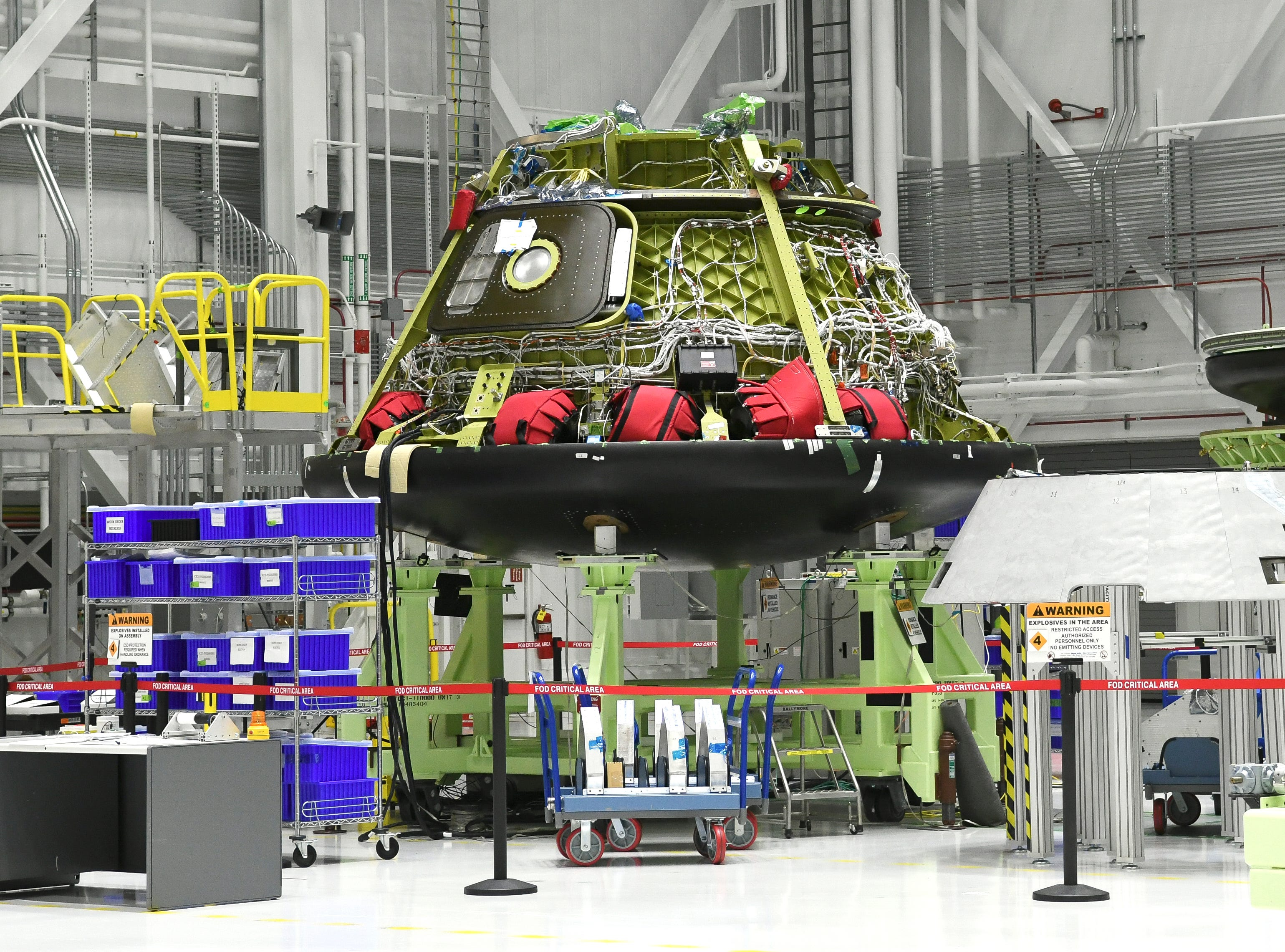 A Starliner test vehicle sits in the Boeing  manufacturing facility at Kennedy Space Center. This one was used for pad abort tests.