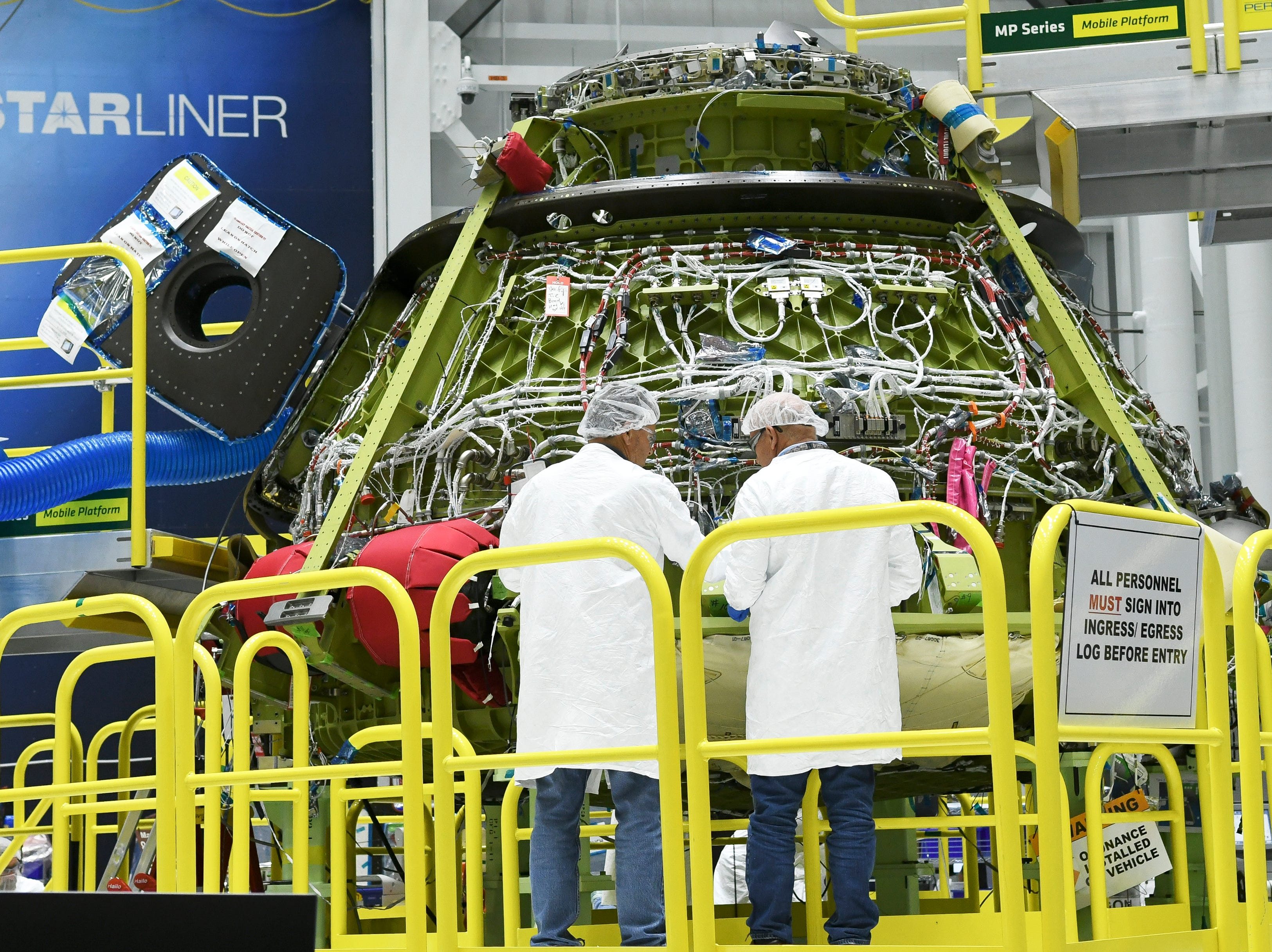 Construction continues on the Starliner crew test vehicle in the Boeing manufacturing facility at Kennedy Space Center.