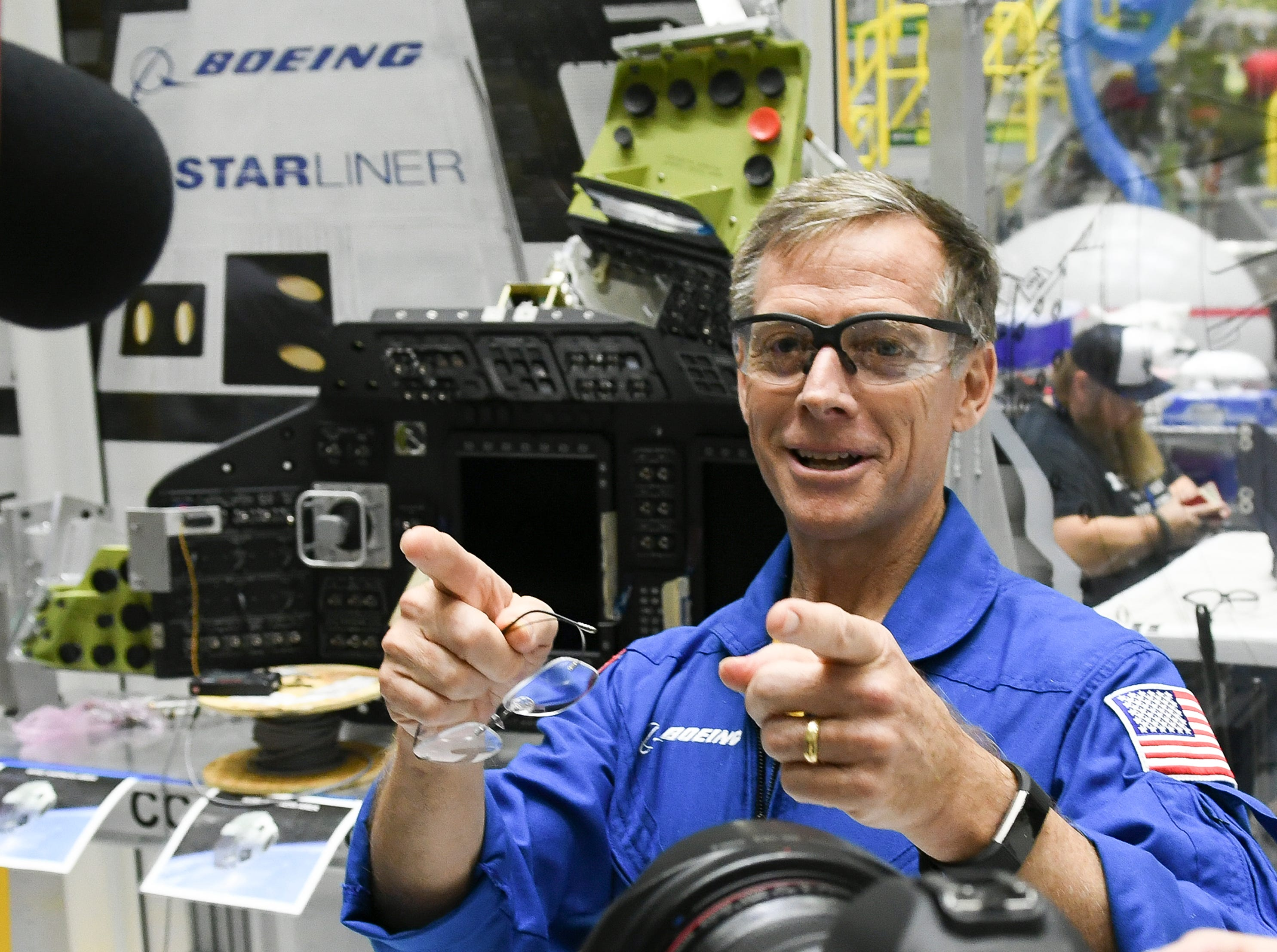 Astronaut Chris Ferguson talks about the features of the Starliner crew test vehicle under construction in the Boeing  manufacturing facility at Kennedy Space Center.