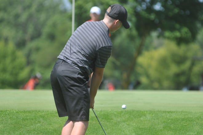 Buckeye Central's Tyler Rose chips onto the  9th green at Clinton Heights GC.