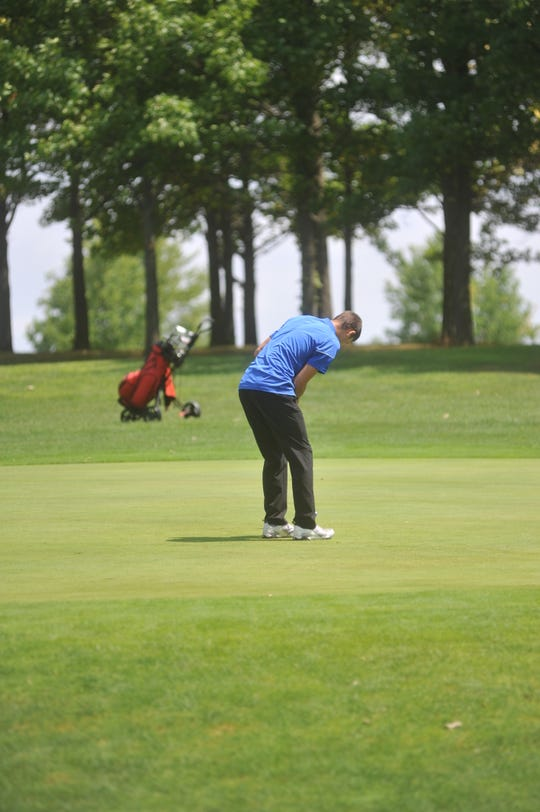 Wynford's Josh Crall putts toward the cup on the  4th hole at Clinton Heights GC.