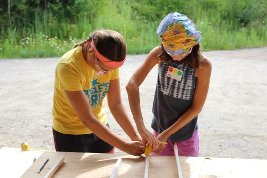 Anna Towne, on the left, is pushing her skills in woodworking this summer at Rosie's Girls Build camp at the Center for Technology in Essex on Aug. 9, 2018.