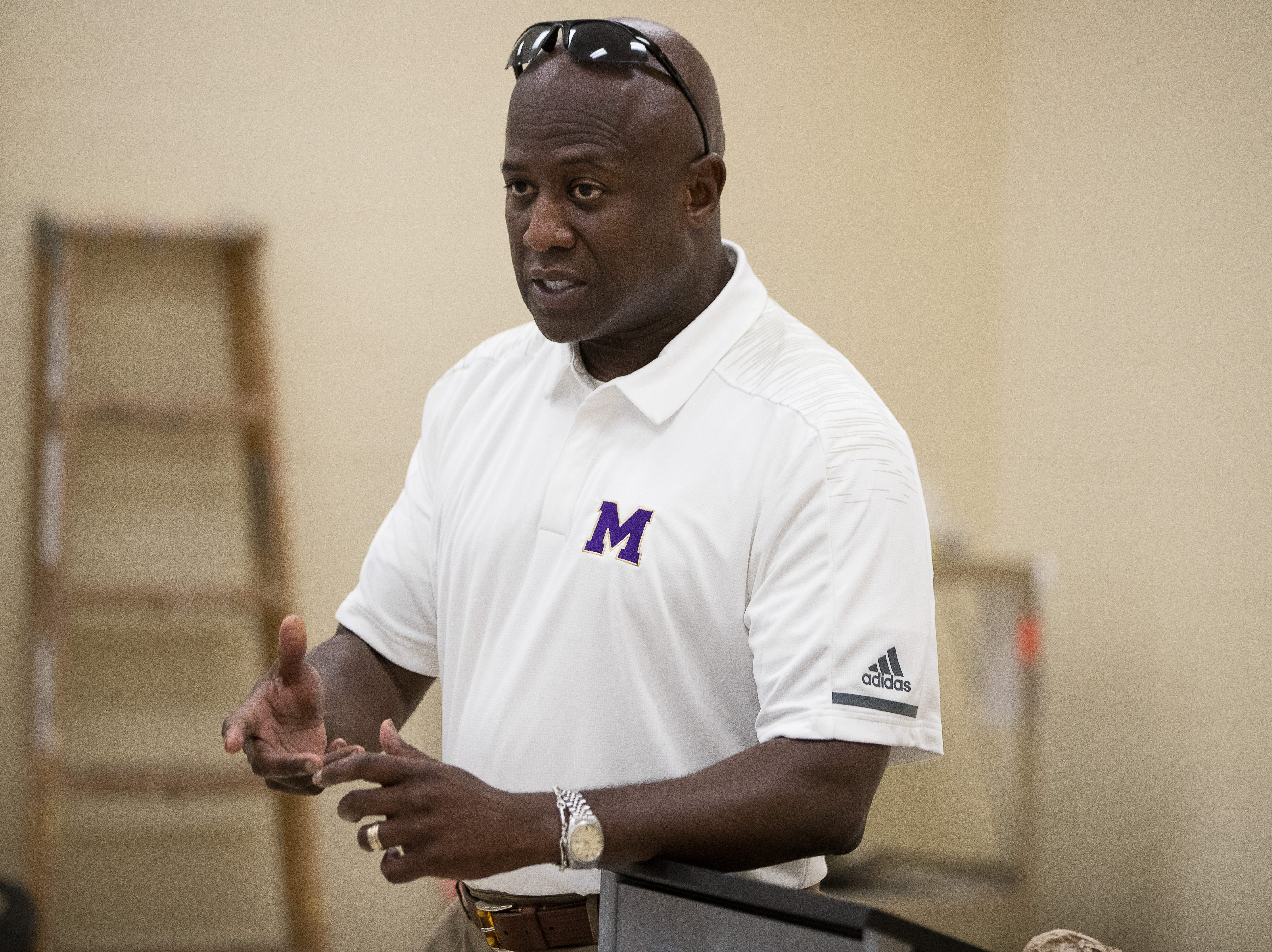 Miller High school's new principal Bruce Wilson talks to the male coaches at new school before the start of the new school year on Thursday, Aug. 9, 2018.