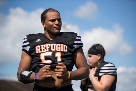 Refugio's Armonie Brown prepares for the upcoming football season at Bobcat Stadium on Thursday, August 9, 2018.