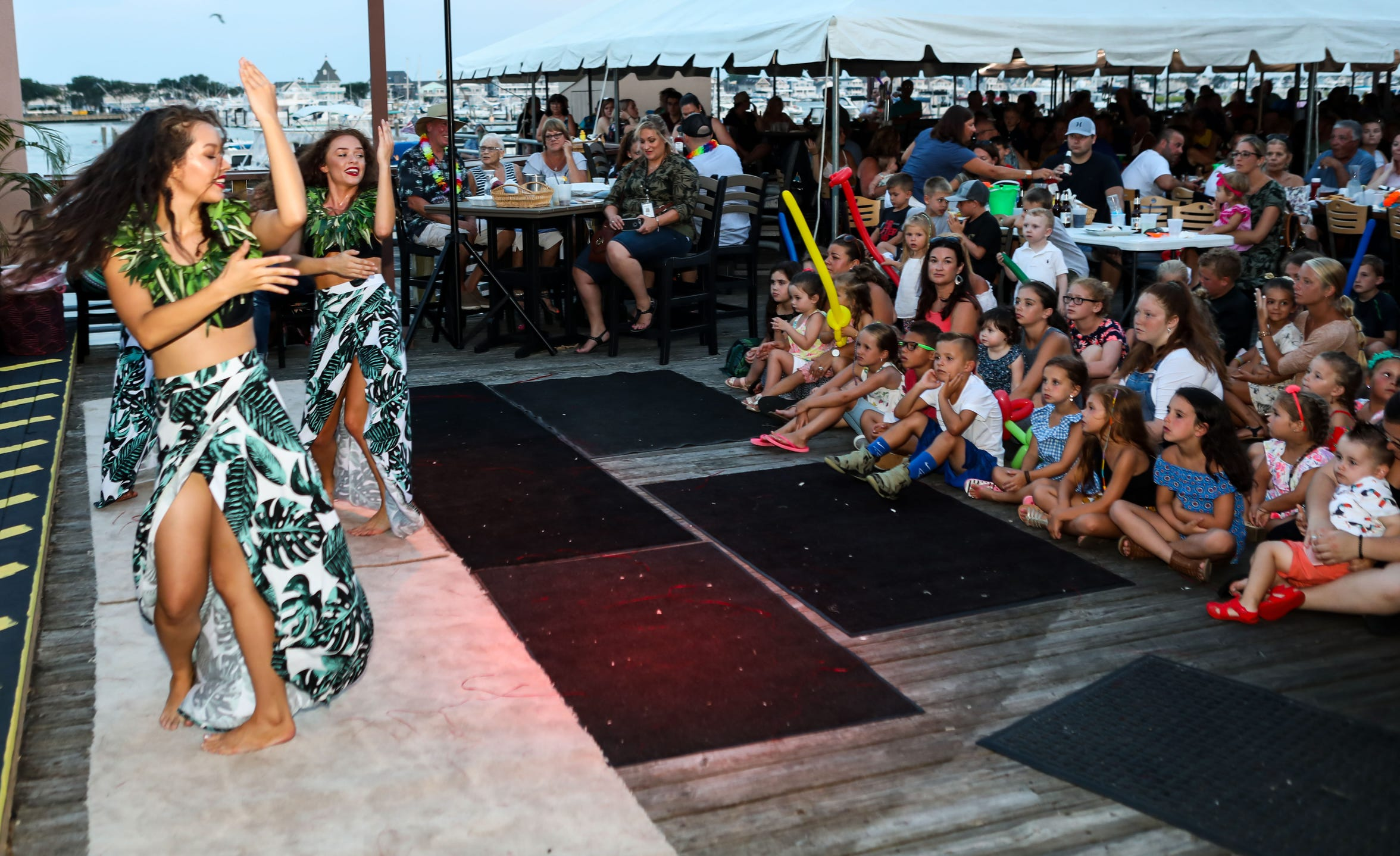Members of Paradise Island Entertainment,  an authentic Polynesian dance troupe from Williamstown, NJ, perform at Toll Man Joe's Bayside in Wildwood Crest, NJ, on Monday,  August 6, 2018.