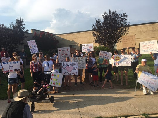 Parents, teachers, students and other supporters hold up signs outside of Teddy Bear Academy in Marlton a few months ago. The rally was held in hopes that the academy will not have to close down after a state judge made a ruling in July. However, the Commissioner of Education recently adopted the judge's ruling, saying the school must close by the end of this school year.