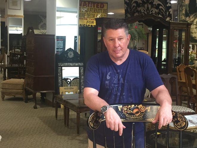 Keith Brookstein, owner of  Keith's Classic Furniture in the Mall at Voorhees Town Center, is keeping his buseness  open until he knows if the mall will be saved or demolished.