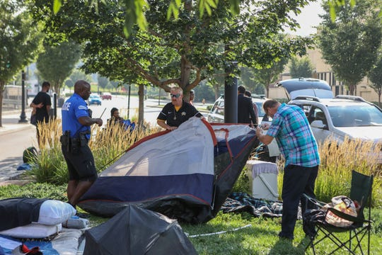 A homeless camp off of Central Ave., across from Jack Casino was disbanded by police. Homeless and volunteers tear down the camp and place their possessions in trucks to be moved again.